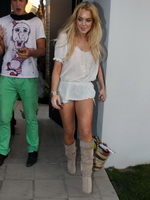 Lindsay Lohan in see-through top, denim shorts  boots arriving to a friend's party in Hollywood Hills from Kendra Exposed