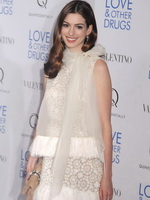 Anne Hathaway leggy in little white lace dress at 'Love  Other Drugs' screening in NYC from CelebMatrix