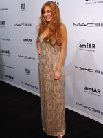 Lindsay Lohan showing huge cleavage at  amfAR New York Gala To Kick Off Fall 2013 Fashion Week from CelebMatrix