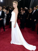 Charlize Theron looks very sexy wearing a strapless white dress at the 85th Annual Academy Awards from CelebMatrix