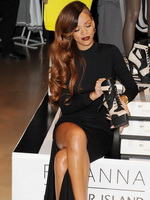 Rihanna shows off her amazing body wearing a tight black dress at River Island collection launch in London from CelebMatrix