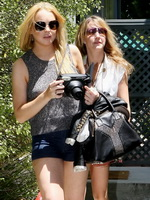 Lindsay Lohan leggy in shorts  boots heading to a pool party in Pacific Palisades from Kendra Exposed