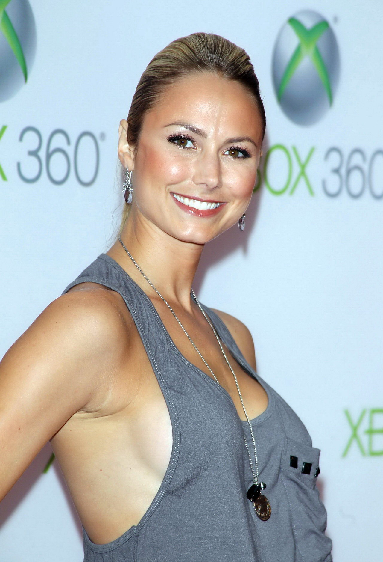 Stacy Keibler braless in tank-top showing side-boob at The ...