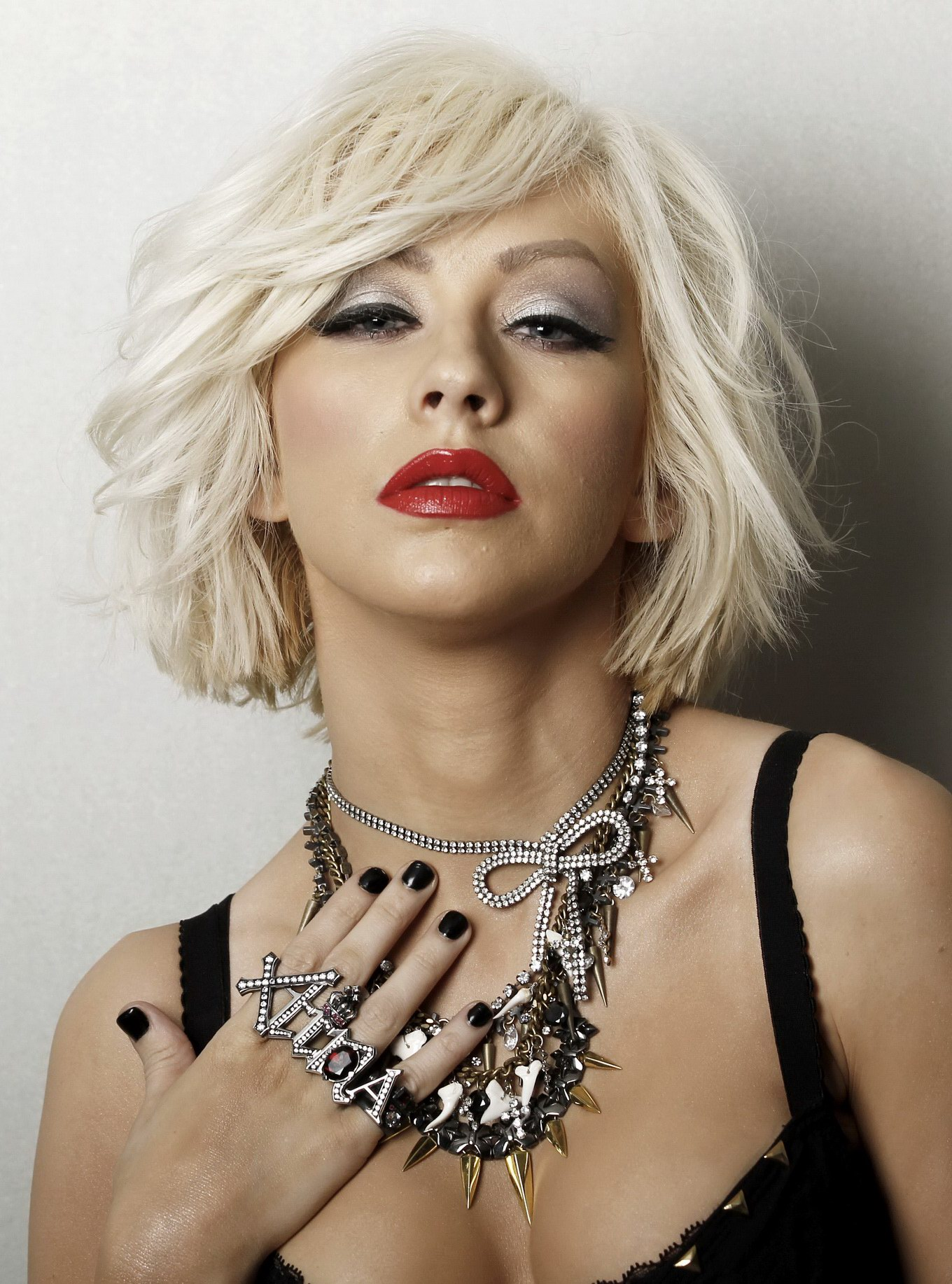 Christina Aguilera busty in black top for M. S. Portraits ... Christina