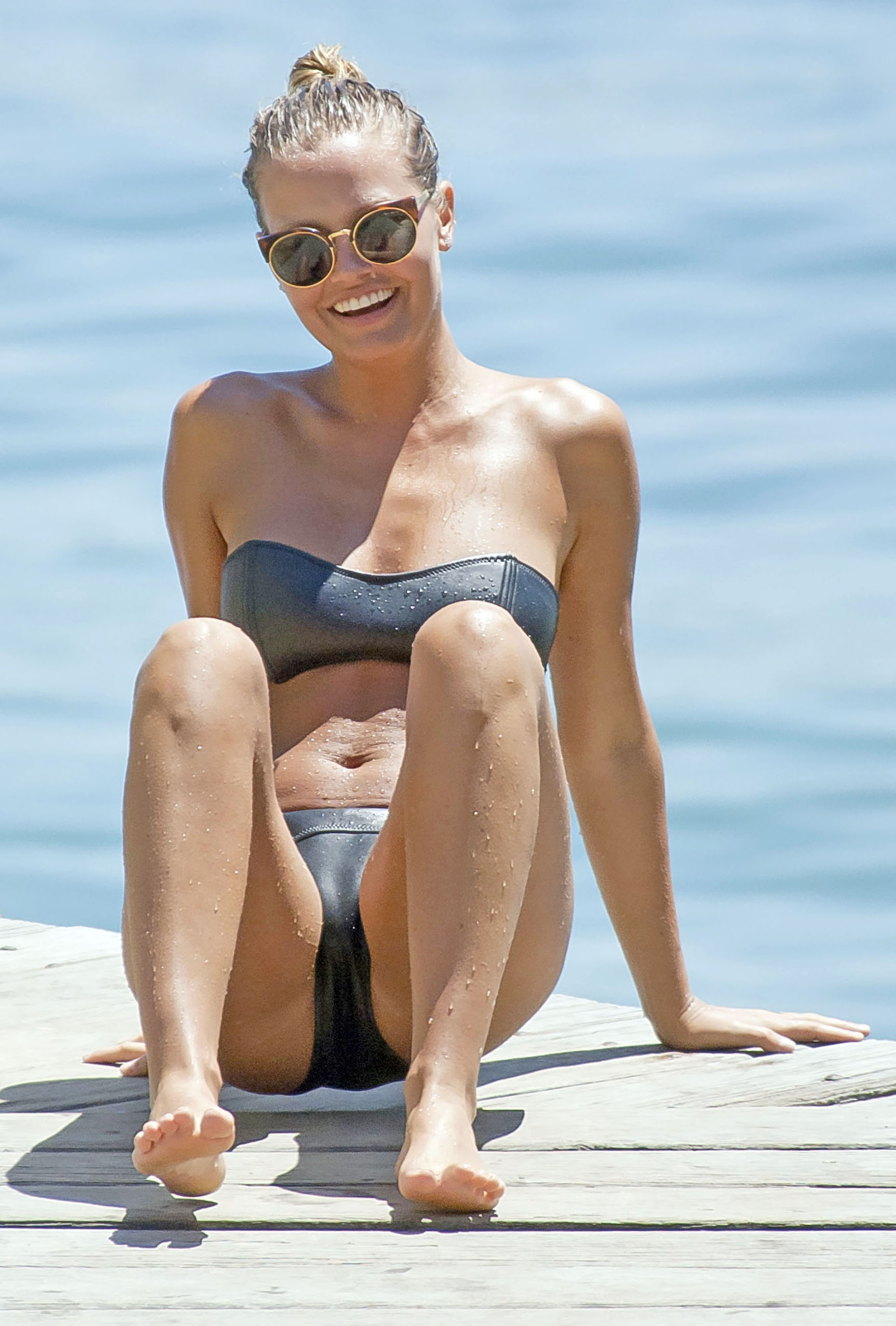 Busty Lara Bingle tanning topless on Bondi Beach in Sydney