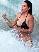 Courteney Cox bikini nip slip on the beach in St. Barts from CelebMatrix