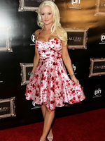 Holly Madison busty wearing low cut dress at Planet Hollywood from CelebMatrix
