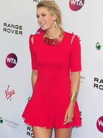 Maria Sharapova leggy wearing red mini dress at WTA Pre-Wimbledon Party from CelebMatrix