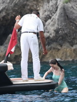 Anne Hathaway shows pokies wearing skimpy wet swimsuit in Italy from CelebMatrix