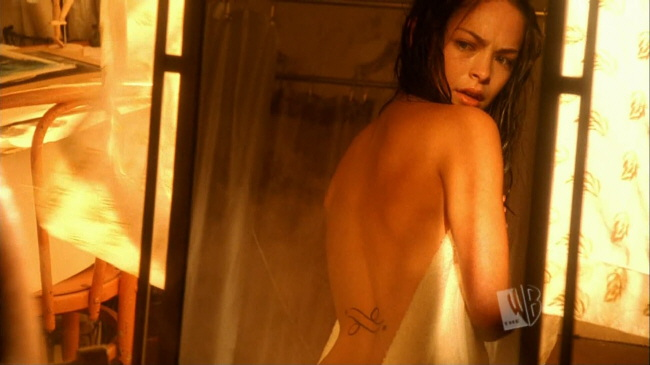 Kristin Kreuk Wearing lacy, white lingerie Which do