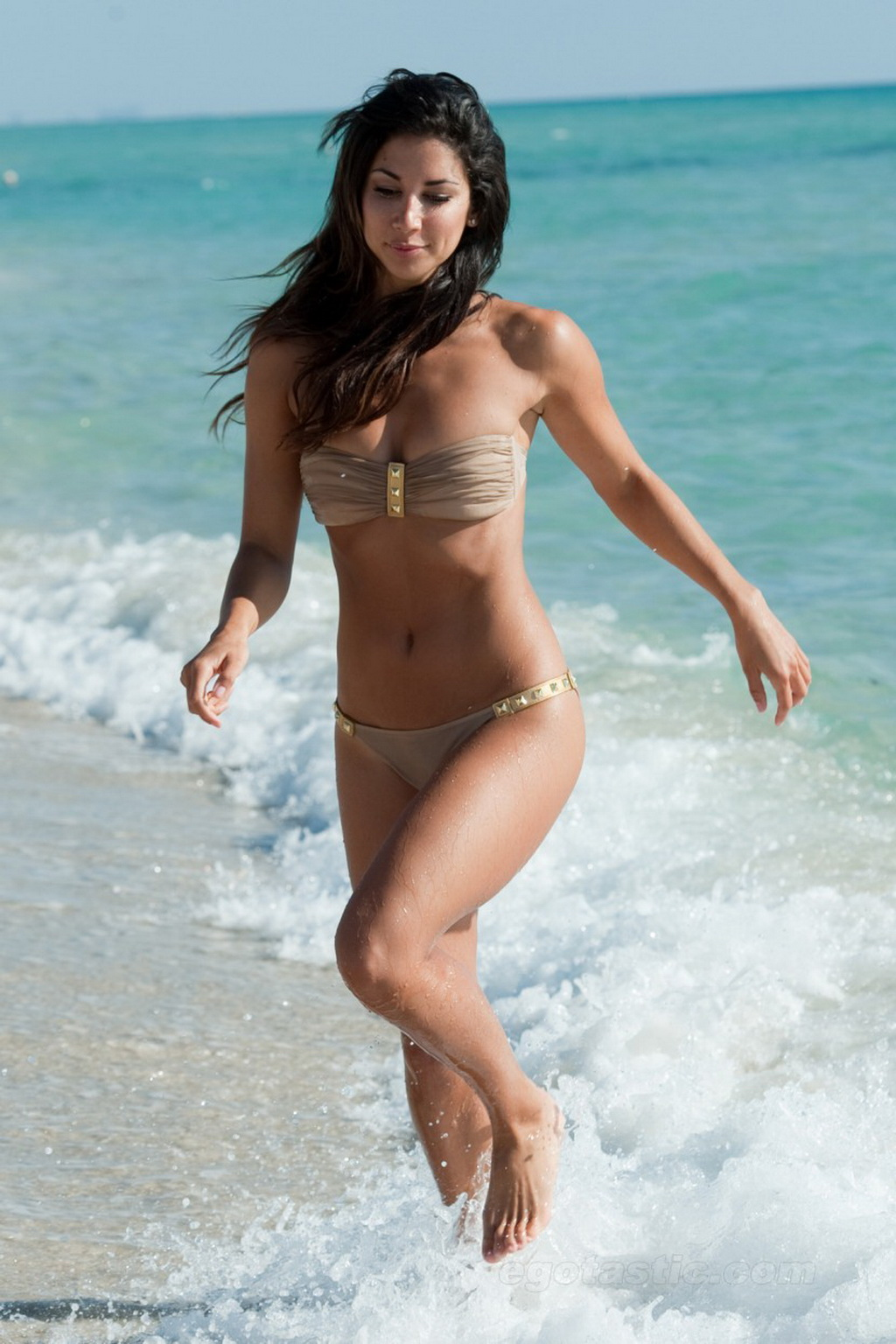 Leilani Dowding topless showing off her small tits on Miami Beach