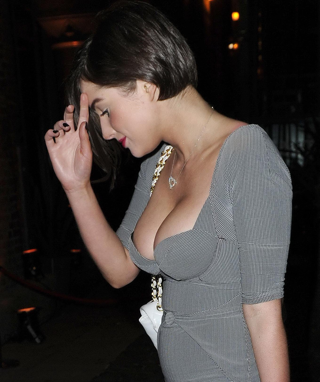 Helen Flanagan busty wearing low cut dress out in Manchester