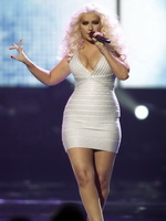 Christina Aguilera shows huge cleavage performing at the American Music Awards in LA from CelebMatrix