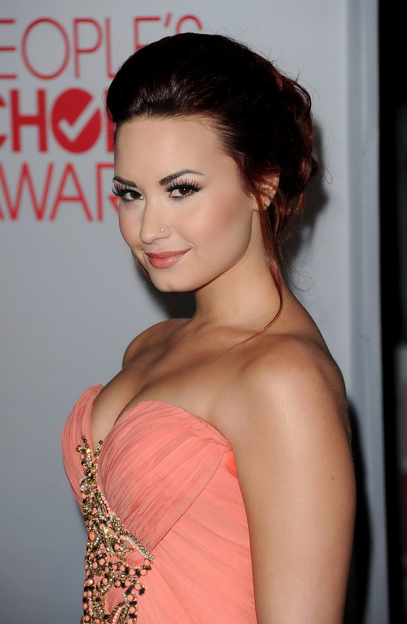 Demi Lovato Shows Cleavage Wearing Strapless Dress At 2012