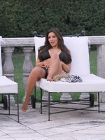 Kim Kardashian wearing sexy black bikini poolside at her friend Loren Ridinger's mega mansion from CelebMatrix