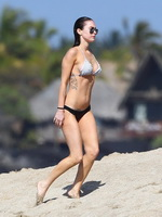 Megan Fox busty wearing skimpy bikini on a beach in Hawaii from CelebMatrix