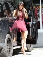 Kim Kardashian leggy wearing a mini dress on the set in Melrose from CelebMatrix