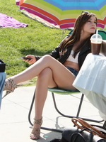Emma Watson leggy wearing denim shorts  belly top on 'The Bling Ring' set from CelebMatrix