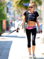 Miley Cyrus shows off her ass  abs wearing tights  belly top in Studio City from CelebMatrix