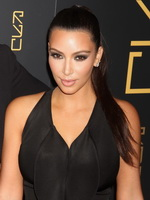Kim Kardashian showing huge cleavage at Jeep  USA Basketball partnership event from CelebMatrix