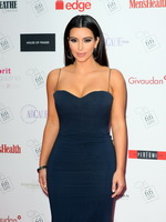 Kim Kardashian busty wearing a low cut maxi dress at FiFi UK Fragrance Awards in London from CelebMatrix