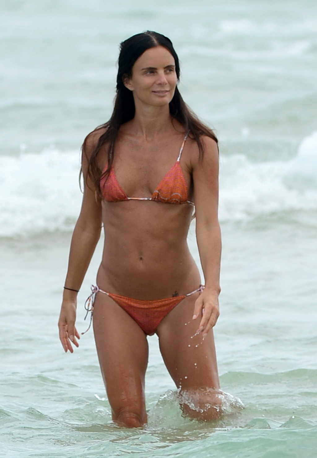 gabrielle anwar showing off her bikini body on a beach in miami from