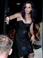 Katy Perry downtop wearing a strapless dress in Hollywood from CelebMatrix