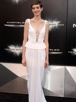 Anne Hathaway showing cleavage in white dress at 'Dark Knight Rises' premiere in NYC from CelebMatrix