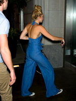 Miley Cyrus shows side boob wearing brace trousers in Philadelphia from CelebMatrix