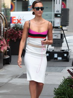 Jessica Alba shows cleavage in low cut dress leaving her hotel in SoHo from CelebMatrix