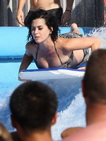 Katy Perry showing her bare ass caused by bikini bottom falling off at the water park in San Dimas from CelebMatrix