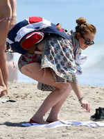 Lindsay Lohan in granny bikini leaving a beach in Malibu from CelebMatrix