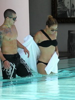 Jennifer Lopez wearing sexy black bikini at a hotel pool in Miami from CelebMatrix