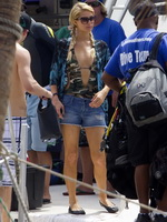 Paris Hilton in camo monokini  denim shorts heading for scuba diving in Hawaii from CelebMatrix