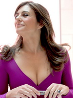 Elizabeth Hurley busty showing cleavage at Estee Lauder Breast Cancer Awareness campaign in England from CelebMatrix