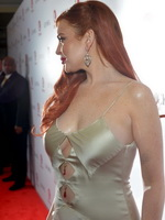Lindsay Lohan showing huge cleavage at 'Liz  Dick' premiere in Beverly Hills from CelebMatrix