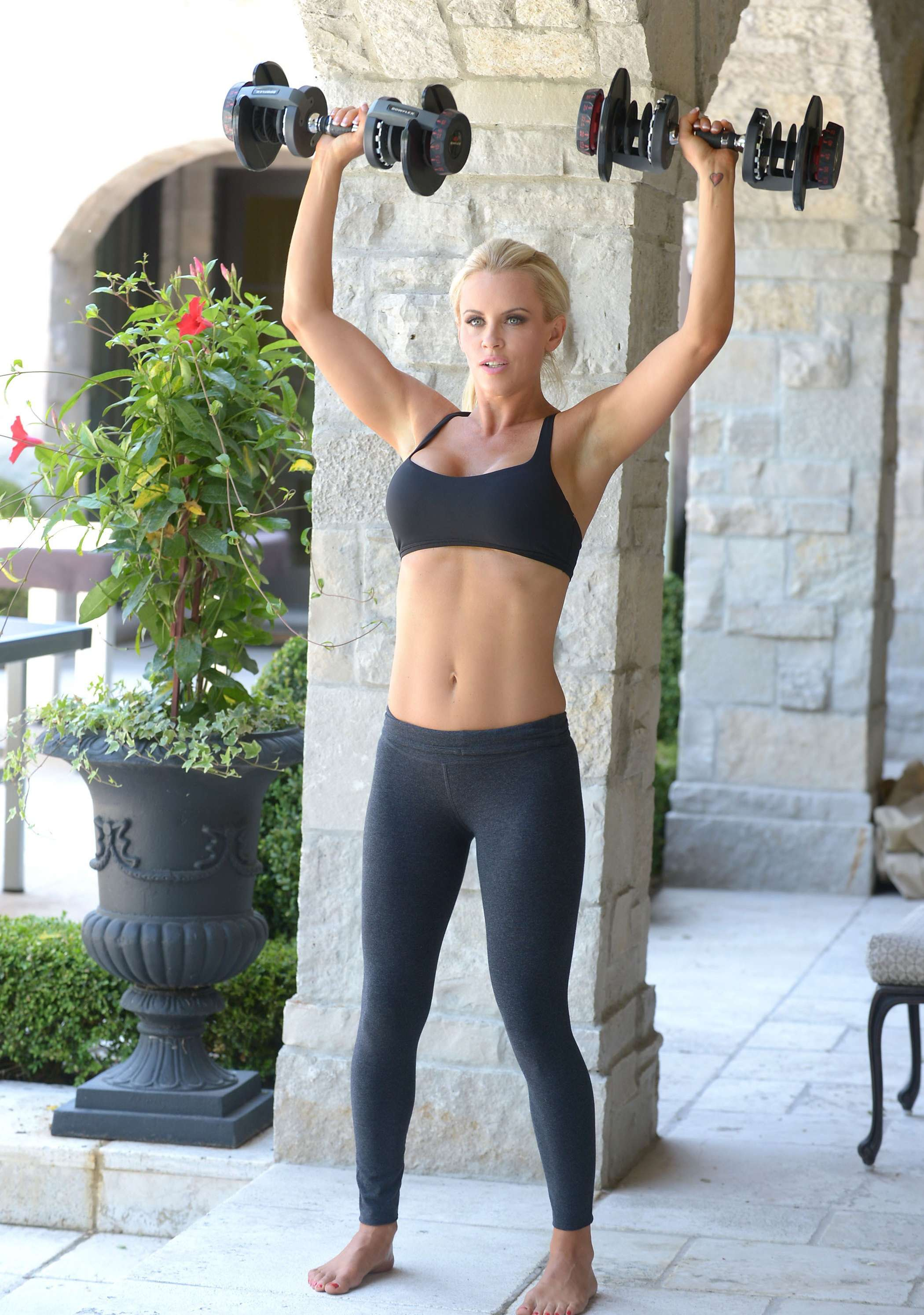 Jenny McCarthy working out in black tights and sports bra
