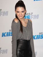 Kendall Jenner leggy wearing a leather mini skirt at KIIS FMs Jingle Ball 2012 in LA from CelebMatrix