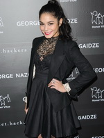 Vanessa Hudgens wearing a black lace dress  pantyhose at Charity Meets Fashion Holiday Celebration in NYC from CelebMatrix
