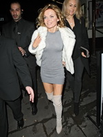Geri Halliwell leggy wearing a tight mini dress  fuckme boots at the Piccadilly Theatre in London from CelebMatrix