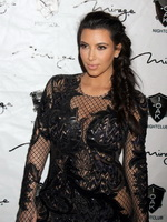 Kim Kardashian in black fishnet dress hosting the New Year's Eve Countdown in Las Vegas from CelebMatrix