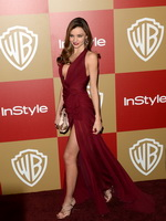 Miranda Kerr leggy  cleavy wearing a sexy red dress at Warner Bros InStyle Golden Globes Party in Beverly Hills from CelebMatrix