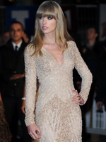 Taylor Swift leggy wearing a mini dress at 2013 NRJ Music Awards in Cannes from CelebMatrix