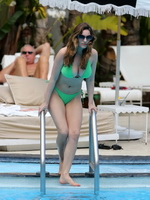 Kelly Brook showing off her curvy bikini body at the pool in Miami from CelebMatrix