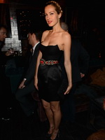 Petra Nemcova busty wearing a black tube dress at the La Perla Fall 2013 Fashion Week Presentation from CelebMatrix