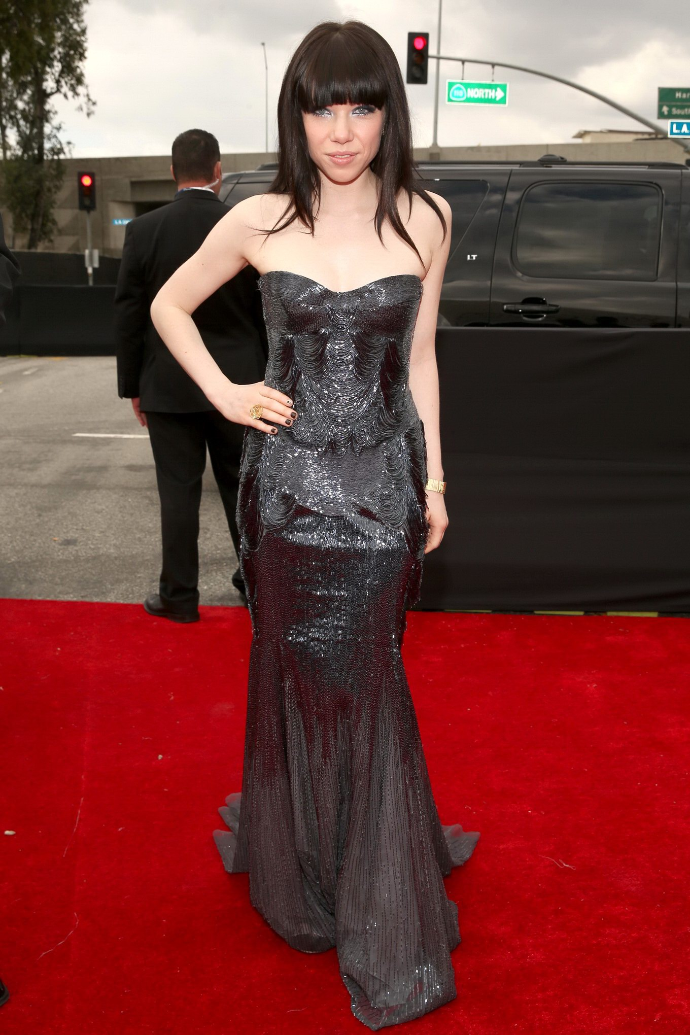 Carly Rae Jepsen cleavy wearing a strapless maxi dress at ...