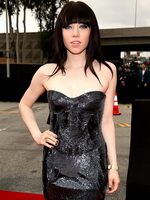 Carly Rae Jepsen cleavy wearing a strapless maxi dress at the 55th Annual Grammy Awards in LA  from CelebMatrix
