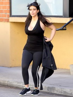 Busty Kim Kardashian in tank top  tights heading to her morning workout at Tracy Anderson Studios in Studio City from CelebMatrix
