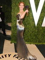 Jennifer Lawrence showing huge cleavage at the 2013 Vanity Fair Oscar Party in West Hollywood from CelebMatrix