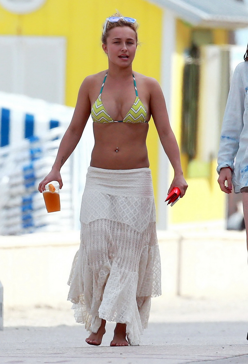 Hayden Panettiere wearing a bikini top & skirt out in Miami